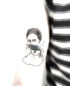 Tattoo mit Kopf abgetrennt. Tattoo Studio Wien 1070